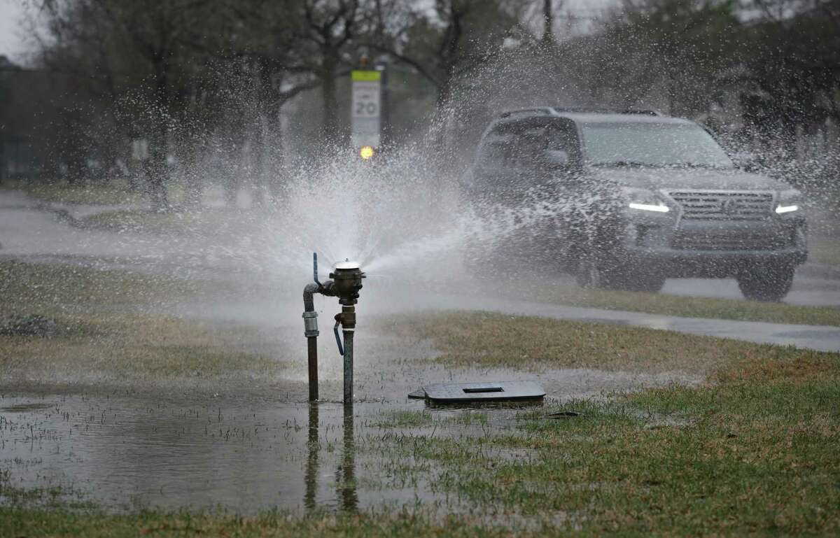 Water spews from an above ground pipe in Pearland after the winter storm. The city has decided that residents looking to repair damage resulting from busted pipes related to the storm won't be subjected to permit fees.