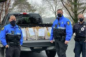 Greenwich police helped distribute food parcels to local families in need after thieves stole parts from vehicles operated by the Transportation Association of Greenwich. The police delivered parcels to dozens of families last week, stepping in to do the work usually handled by TAG.