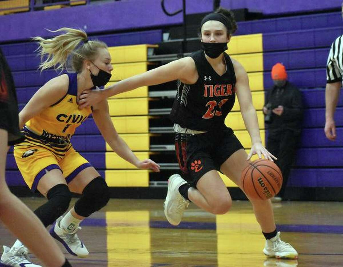 Edwardsville's Sydney Harris, right, works past a Civic Memorial defender and takes the ball to the basket during a game earlier this season.