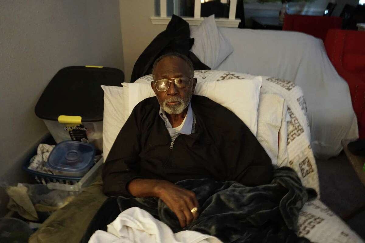 A.L. Curry, 92, poses on Friday, Feb. 19, at his home in Brookshire, where a crew from Kingsland Baptist Church in Katy was cleaning out rooms flooded during a historic winter storm.