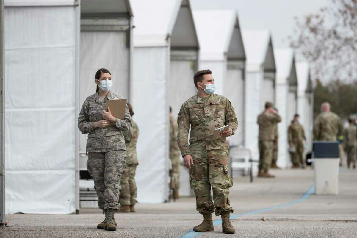 Military personnel prepare to check people in at a Federal Emergency Management Agency COVID-19 vaccination super site at NRG Park Wednesday, Feb. 24, 2021 in Houston. Harris County Judge Lina Hidalgo posted on twitter that people to receive vaccines will be selected from the county and the City of Houston's waitlist. The site will vaccinate 42,000 people a week for three weeks, she said.