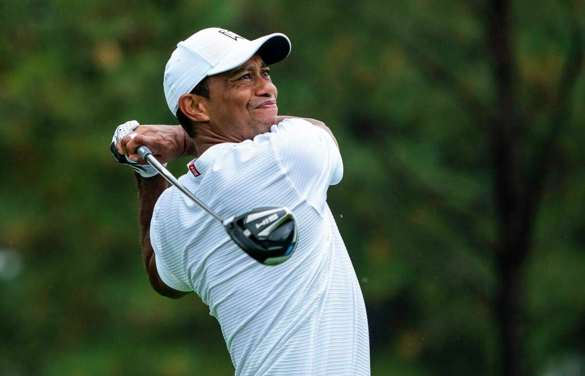 Tiger Woods suffered multiple leg injuries and went into surgery after crashing his car in Los Angeles County on Tuesday morning.