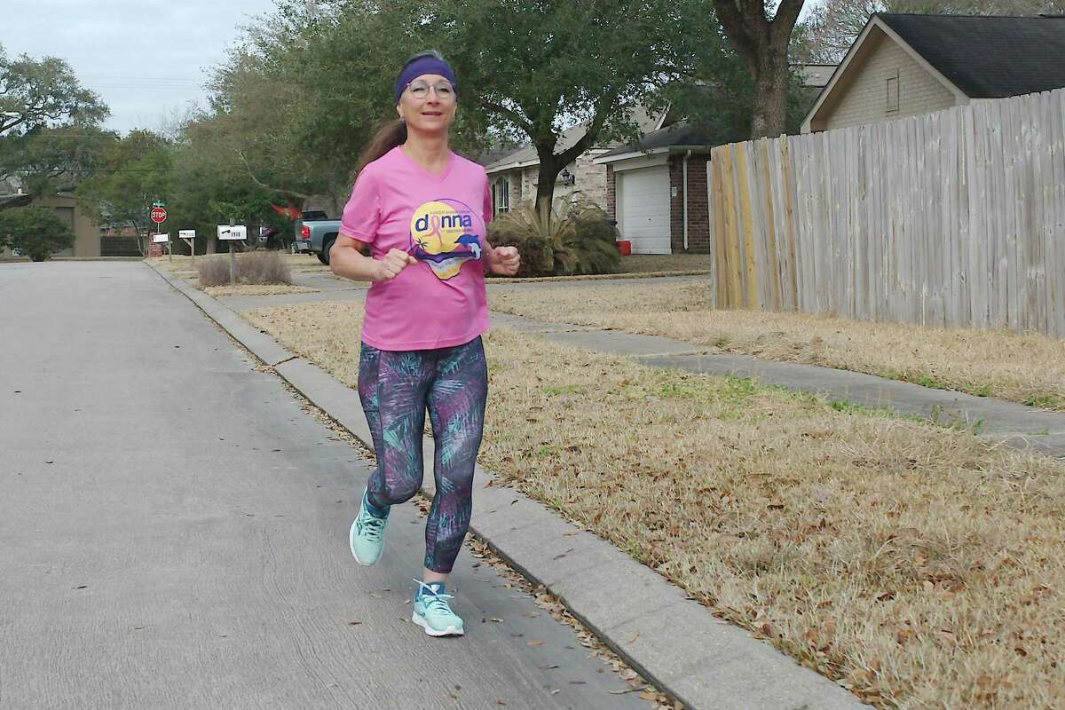Donna Sue Sledge runs through her neighborhood as she trains for March races. She started running in 2014 at age 55 and has completed several marathons and numerous races of lesser distance.
