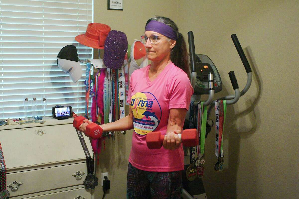 Donna Sue Sledge supplements her outdoor runs with indoor elliptical and weight training as she prepares for upcoming races.