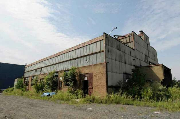 An abandoned industrial site that's primed for redevelopment. It's a five acre site where the Beacon Institute is planning a $15 million education center, and additional development could occur there. Progress has been slow, but the site is seen as a catalyst for the transformation of the entire waterfront in Troy on Friday.9/03/2010. ( Michael P. Farrell / Times Union ) Photo: Michael P. Farrell