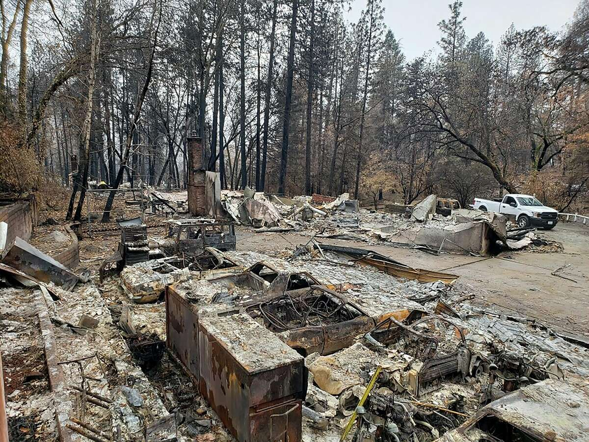 The aftermath of the Camp Fire in Paradise - the trust that handles payments for victims is seeking settlements from former PG&E executives and board members.