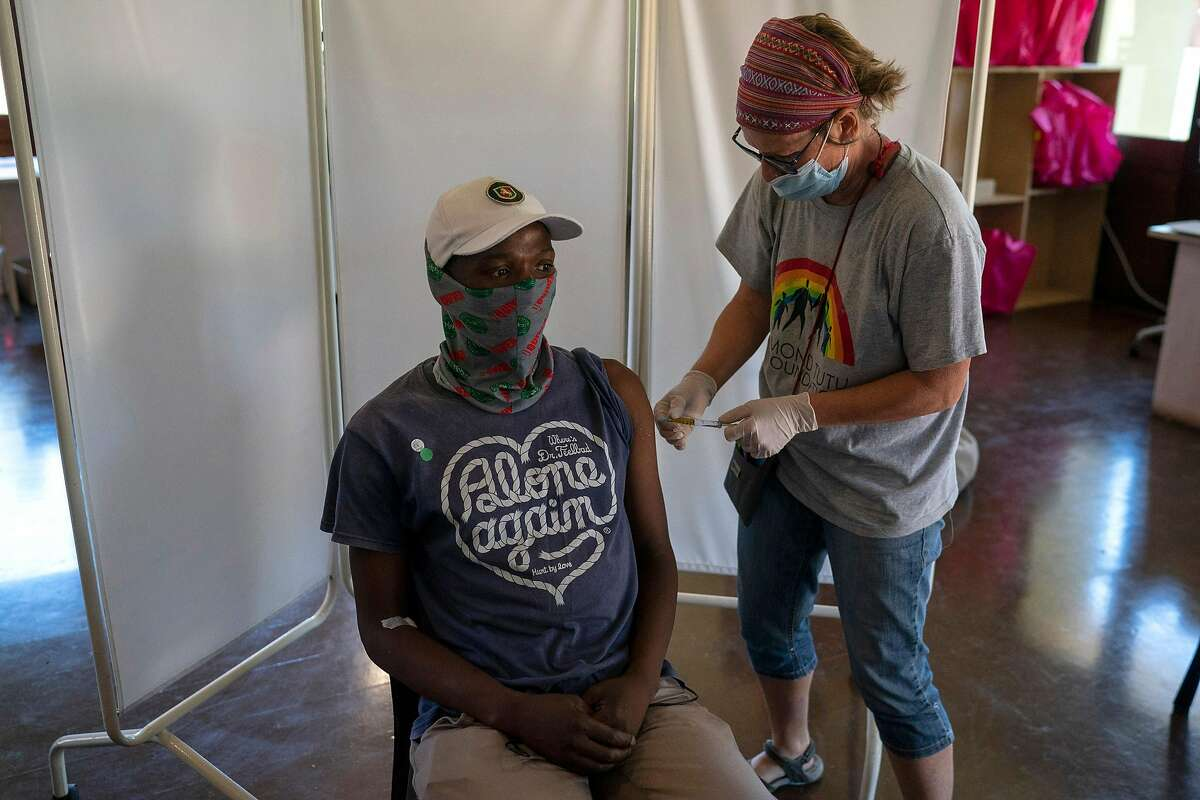 A participant gets a shot in a Johnson & Johnson vaccine trial in South Africa. The vaccine has cleared a key efficacy and safety hurdle enroute to anticipated approval by the Food and Drug Administration for emergency use.