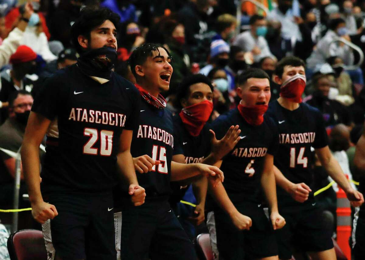 Atascocita players react after a basket during the fourth quarter of a District 21-6A high school basketball game at Summer Creek High School, Wednesday, Dec. 16, 2020, in Atascocita. Atascocita defeated Summer Creek 68-58.