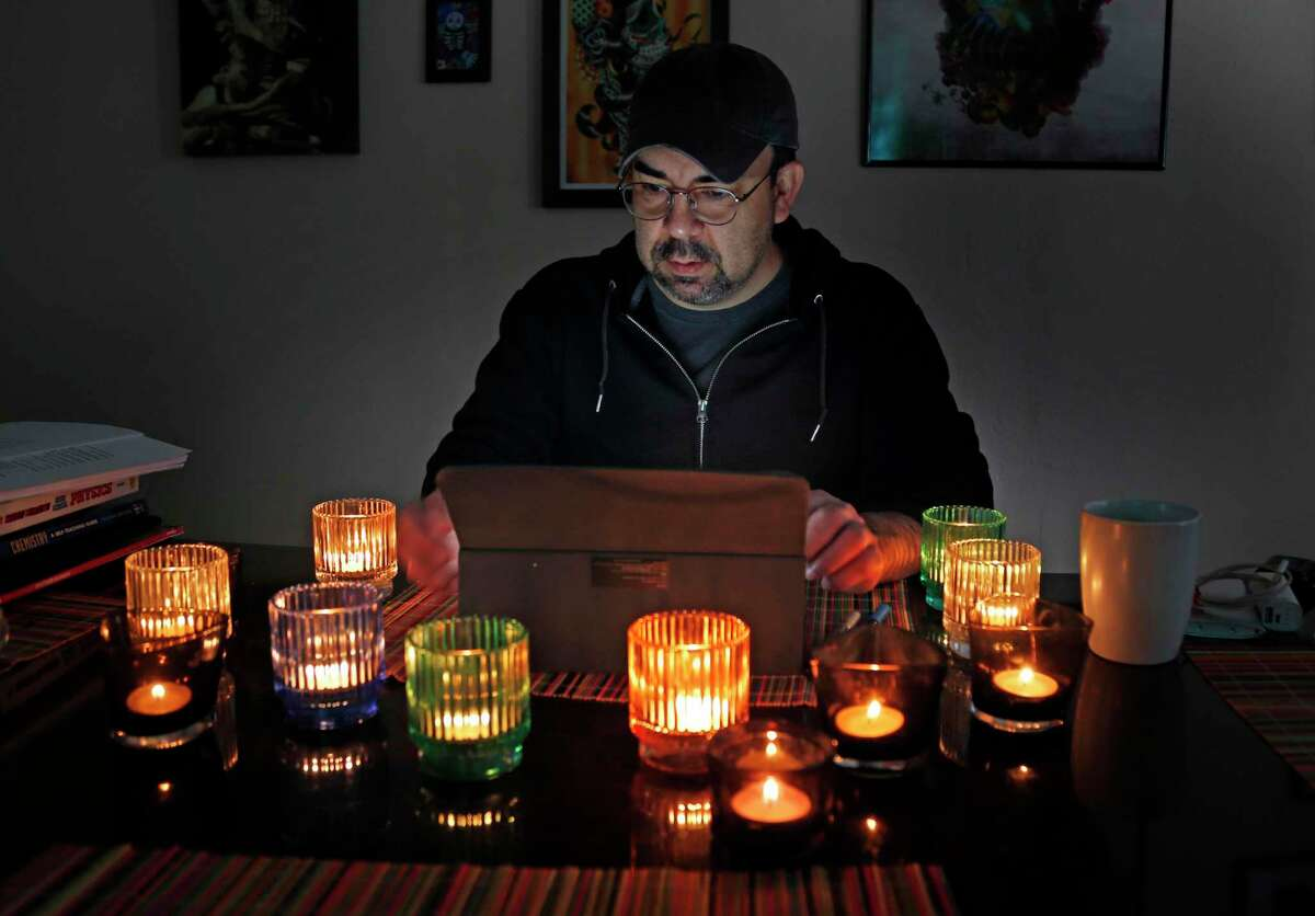 Chef Dave Terrazas shows how he set up his tea light candles to spread light evenly around his house during last week's Arctic storms.
