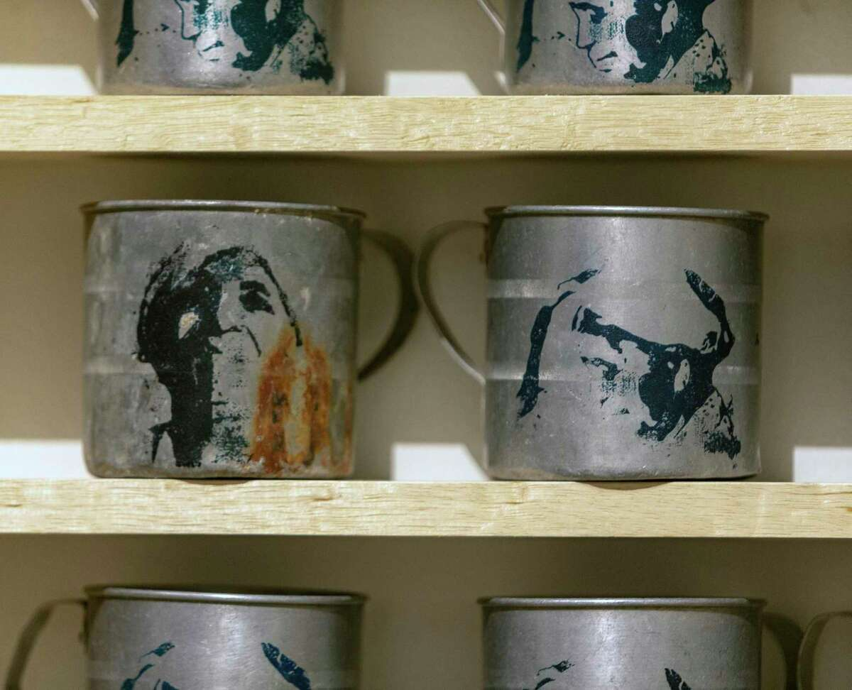 """Screenprints depicting artist Djiradj Ramsamoedj's grandmother are on the front of mugs similar to those used in her home in Ramsamoedj's installtion, """"Adjie Gilas."""" The name translates as """"Grandmother's Cup."""""""