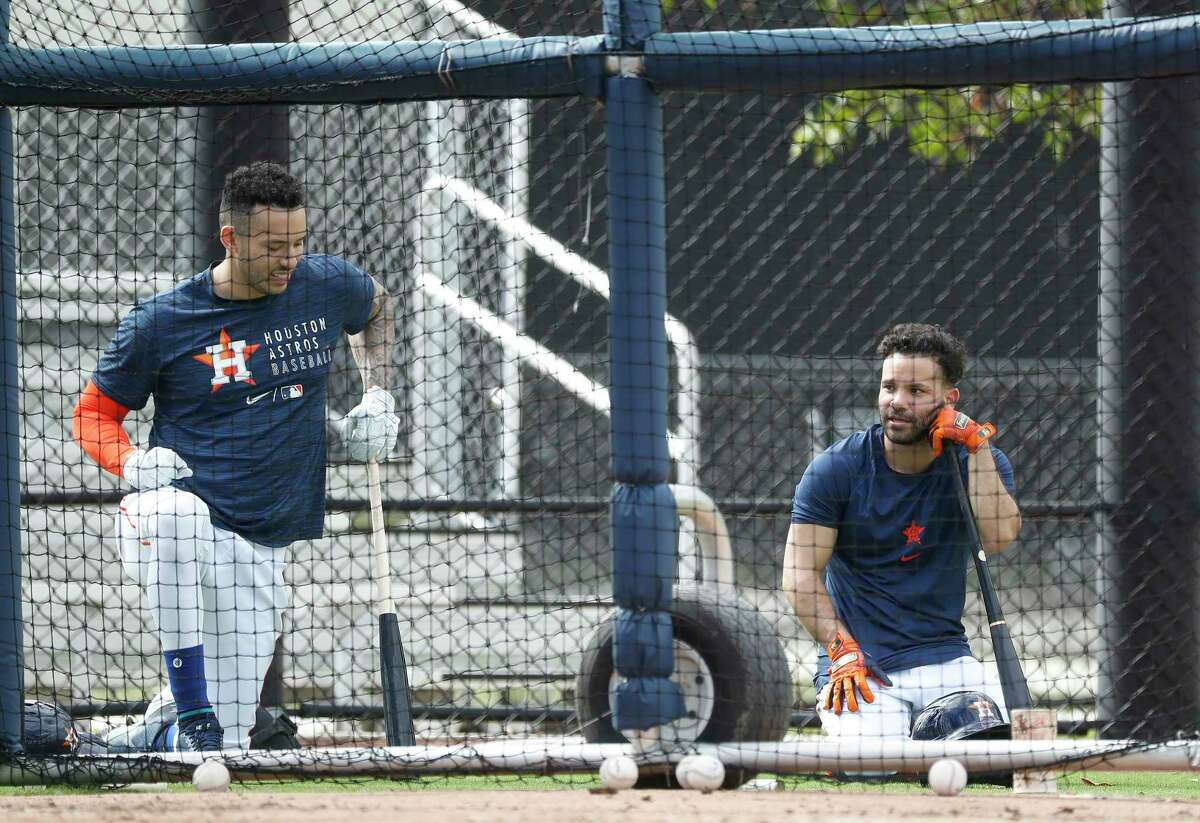 Houston Astros Carlos Correa and Jose Altuve during batting practice during the third day of full-squad workouts for the Astros at Ballpark of the Palm Beaches in West Palm Beach, Florida, Wednesday, February 24, 2021.