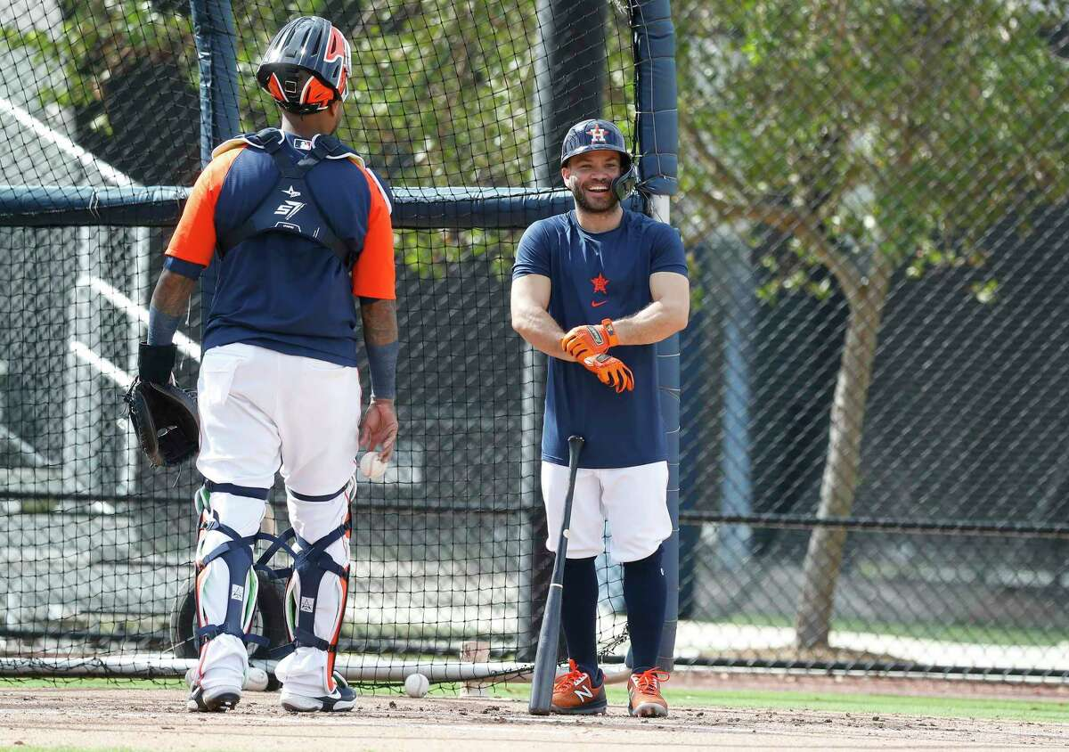 Houston Astros second baseman Jose Altuve (27) smiles during batting practice during the third day of full-squad workouts for the Astros at Ballpark of the Palm Beaches in West Palm Beach, Florida, Wednesday, February 24, 2021.
