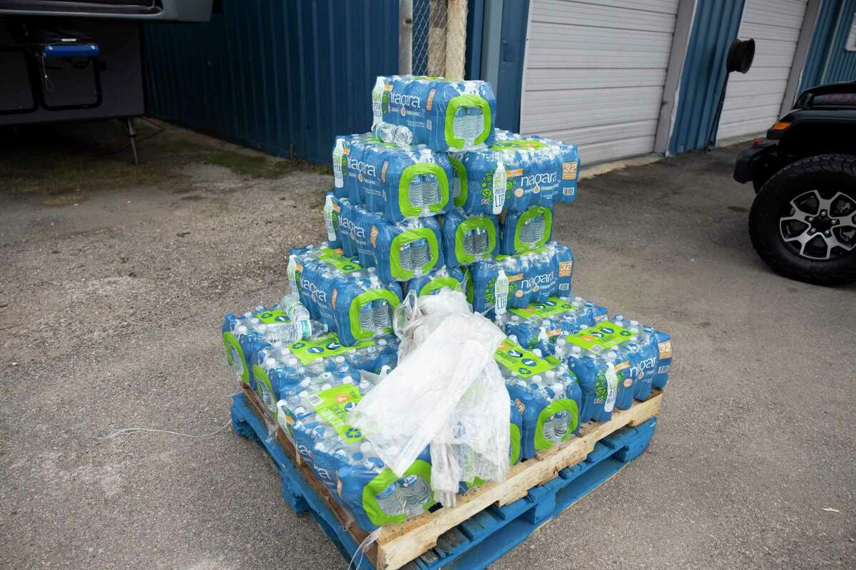 As seen, a small number of cases of water sit on a pallet after suspected burglars stole a trailer of cases at the Dream Center on Wednesday in Splendora. The organization planned to distribute juice and water that was stolen to the elderly in the community.