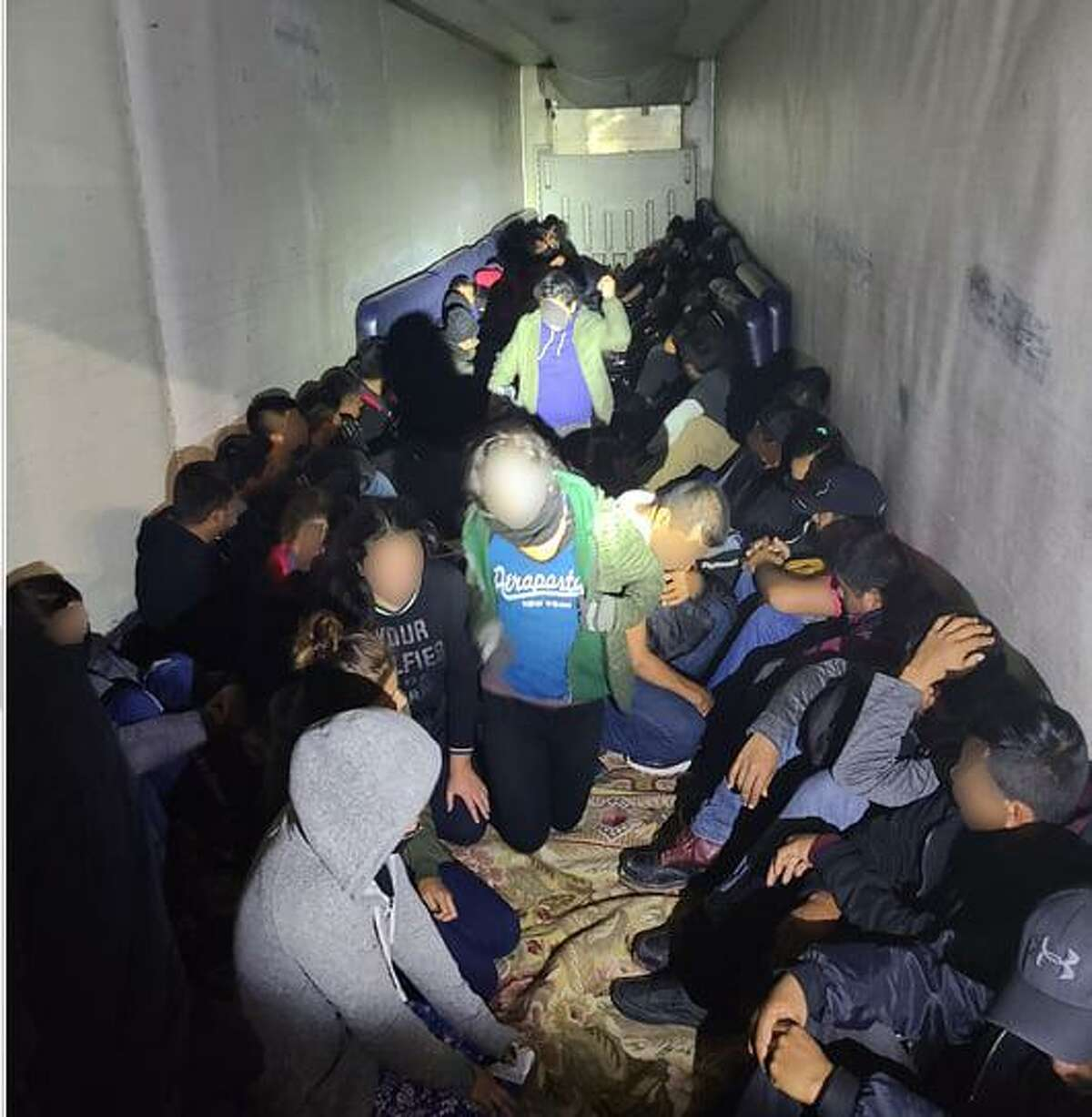 U.S. Border Patrol agents said they discovered these 72 people in the back of a trailer. All were determined to be immigrants who had crossed the border illegally.