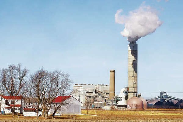 The Sioux Energy Center in Portage De Sioux, Missouri, puffs out steam Wednesday in sight of Alton and the Great River Road. Three environmental groups have filed notice of their intent to sue Ameren over coal ash they allege could enter the Mississippi River.