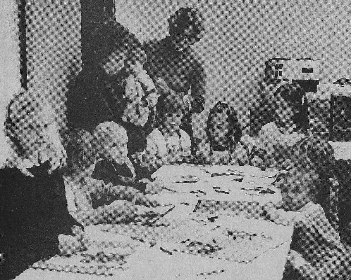(From left) Anita Aves and Charlotte Tabaczka supervise craft projects being enjoyed by the children of Manistee Modern Mothers Child Study Club. Three times a year, events are held involving the club members' children with various development projects such as painting and string necklaces included in the craft night agenda. The photo was published in the News Advocate on Feb. 25, 1981.