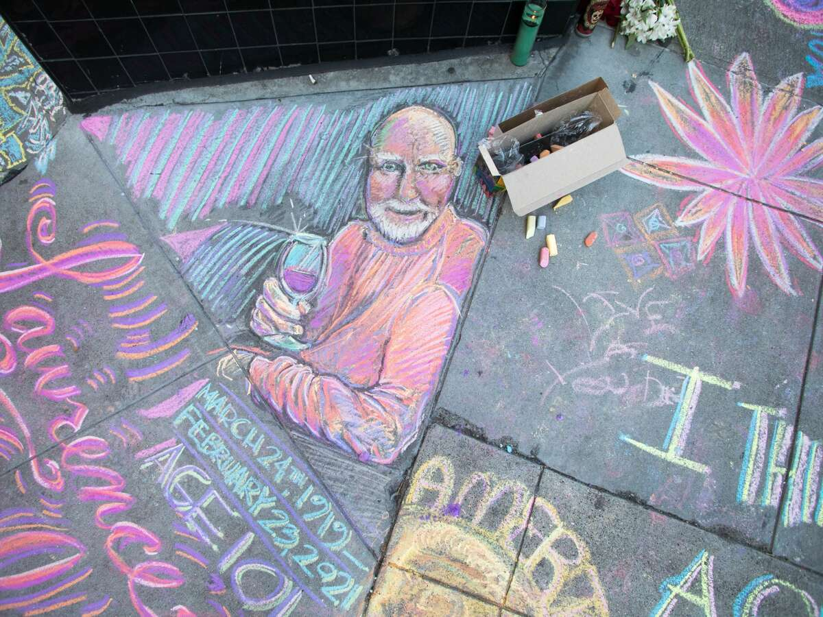 Chalk art covers the sidewalk in front of City Lights bookstore in North Beach. An impromptu memorial in honor of Lawrence Ferlinghetti appeared overnight in front of City Lights Booksellers & Publishers in San Francisco on Feb. 24, 2021.