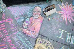 Chalk art covers the sidewalk in front of City Lights bookstore in North Beach. An impromptu memorial in honor of Lawrence Ferlinghetti appeared overnight in front of the City Lights Bookstore in San Francisco, Calif. on Feb. 24, 2021.