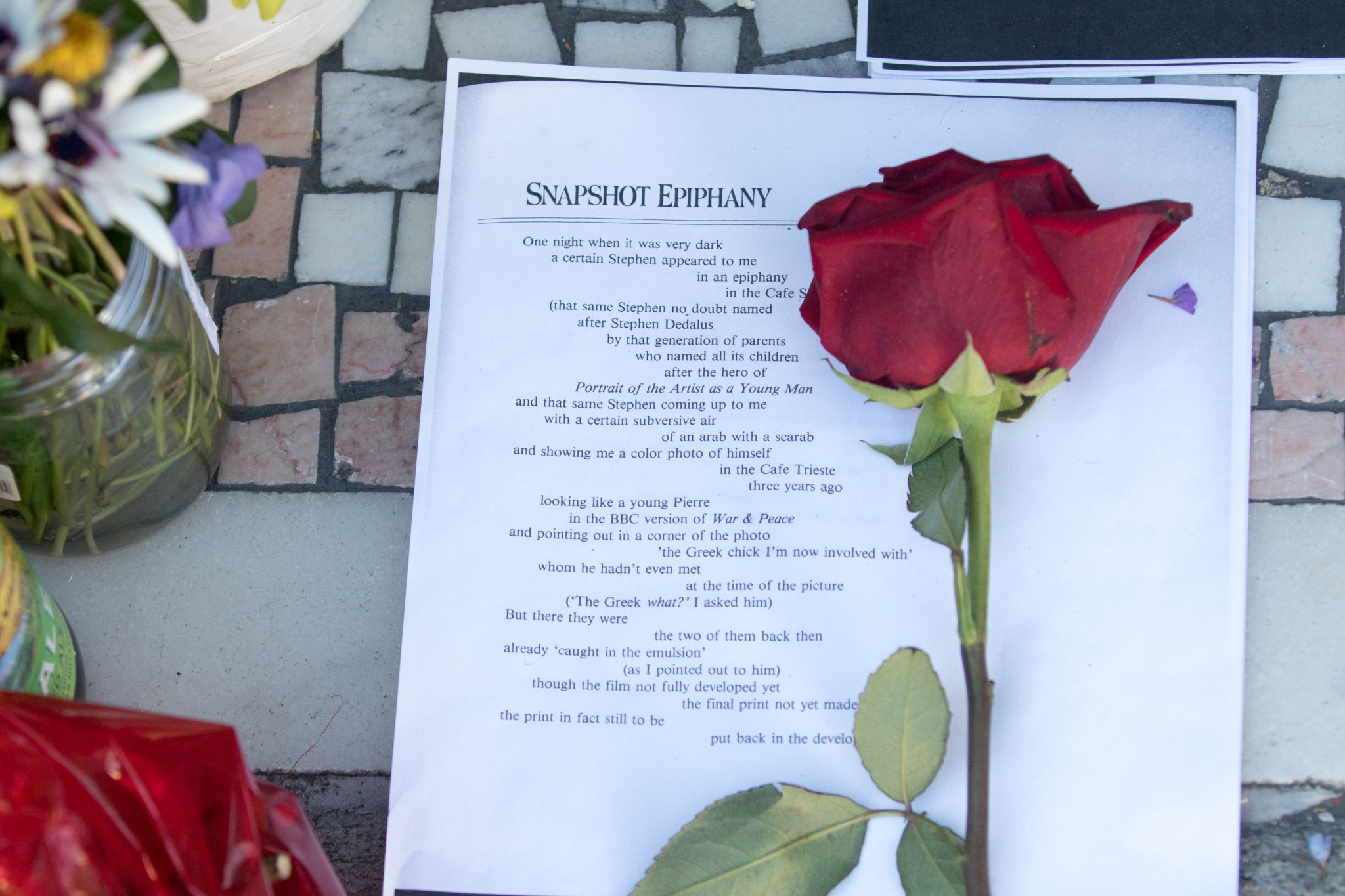 A rose and poem are part of an impromptu memorial in honor of Lawrence Ferlinghetti that appeared overnight in front of City Lights Booksellers & Publishers in San Francisco on Feb. 24, 2021.