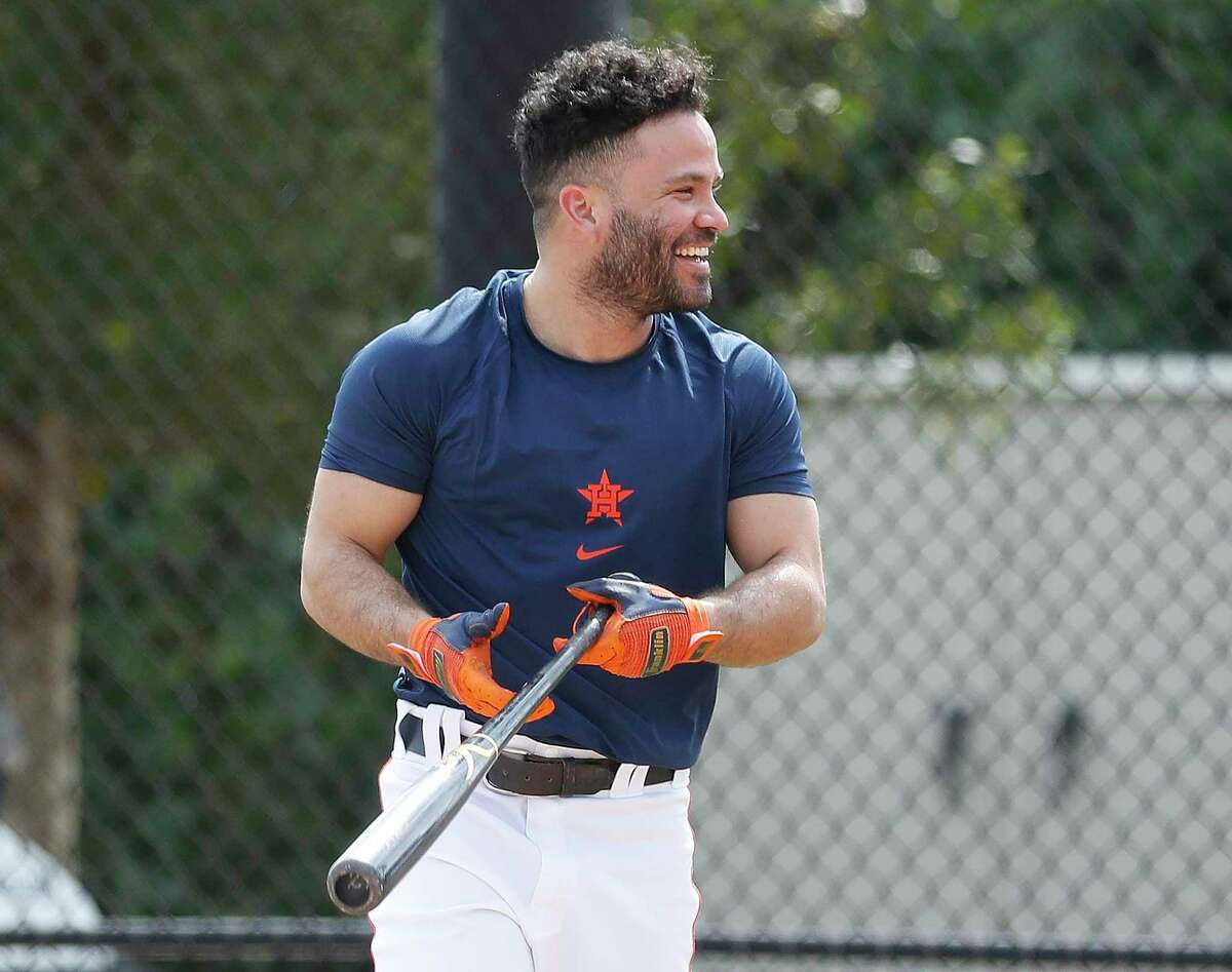 Astros second baseman Jose Altuve, who said he spent more time working on his hitting and fielding than in any previous winter, has a laugh during Wednesday's spring training workout at West Palm Beach, Fla.