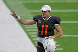 National Team quarterback Sam Ehlinger of Texas (11) waves to fans after the NCAA college football Senior Bowl in Mobile, Ala, Saturday, Jan. 30, 2021. (AP Photo/Rusty Costanza)