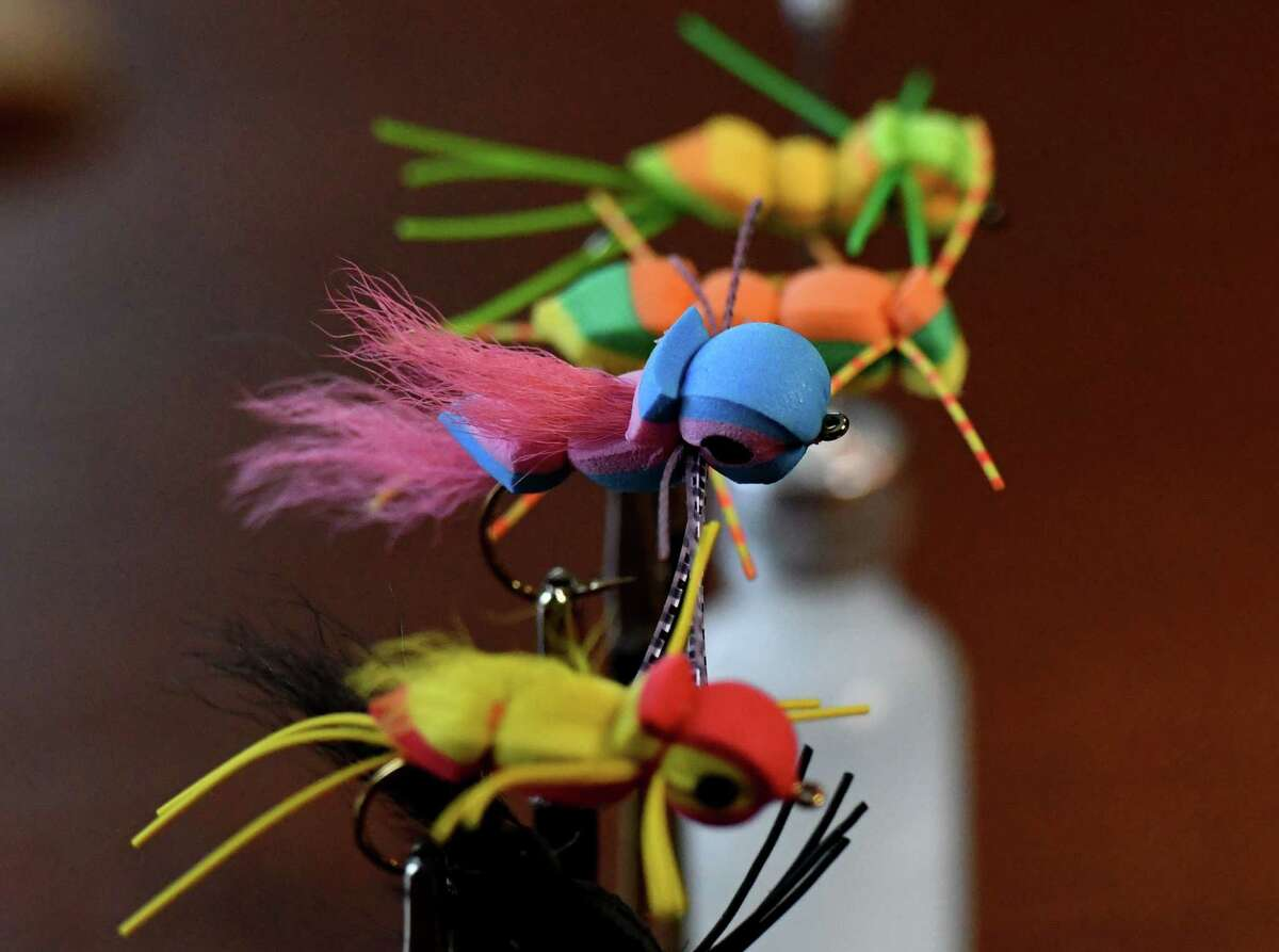 Bass flies made by Richard Atkinson, of Clearwater Trout Unlimited and Capital District Fly Fishers, on Wednesday, Feb. 24, 2021, at his home in Niskayuna, N.Y. (Will Waldron/Times Union)