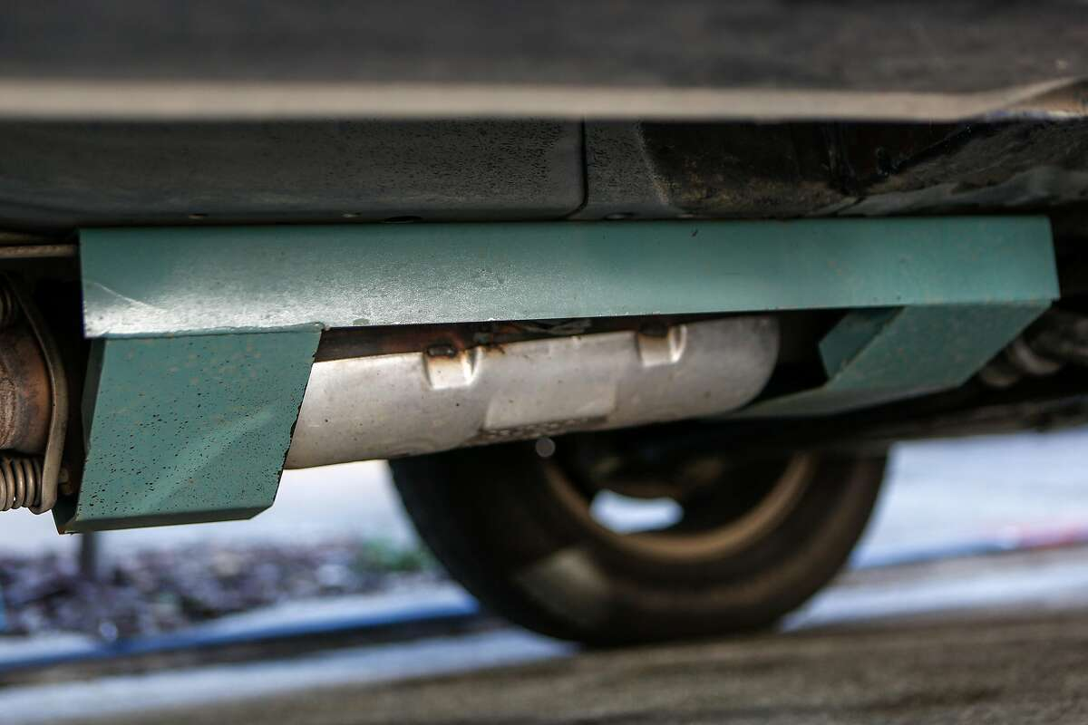 The steel plate protecting Janice Suess' catalytic converter is seen on her Honda Element on Sunday, February 21, 2021 in San Francisco, Calif. Guess had the stolen off her Honda Element not once but twice in the last six months, costing her thousands to replace.