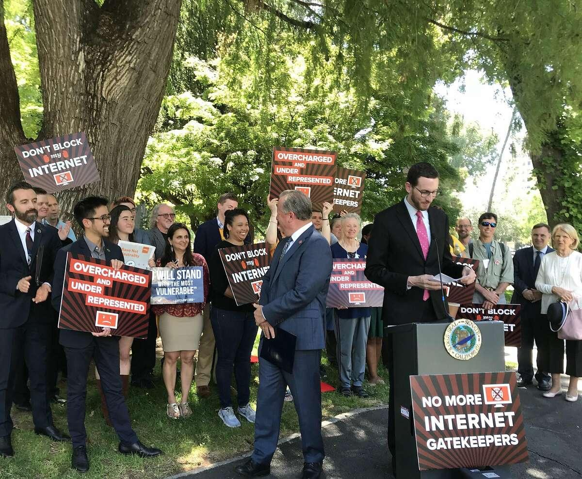 State Sen. Scott Wiener, D-San Francisco, speaking to consumer and internet activists in Sacramento in 2018.