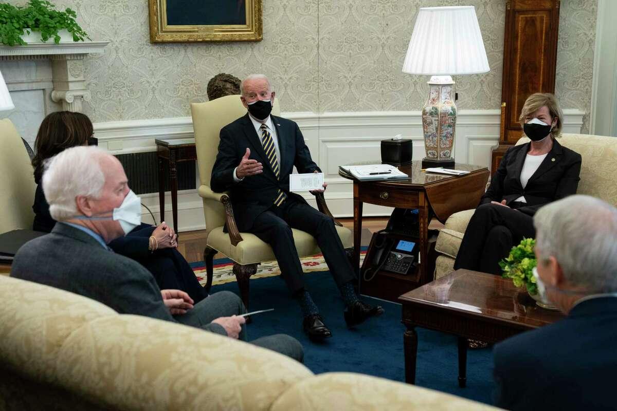 President Joe Biden speaks during a meeting with lawmakers to discuss U.S. supply chains, in the Oval Office of the White House, Wednesday, Feb. 24, 2021, in Washington, as from left, Vice President Kamala Harris, Senate Minority Whip Sen. John Cornyn, R-Texas, Biden, Sen. Tammy Baldwin, R-Wis., and Sen. Rob Portman, R-Ohio, listen. (AP Photo/Evan Vucci)