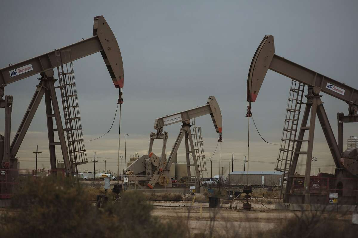 Pump Jacks extract crude oil from oil wells in Midland, Texas.