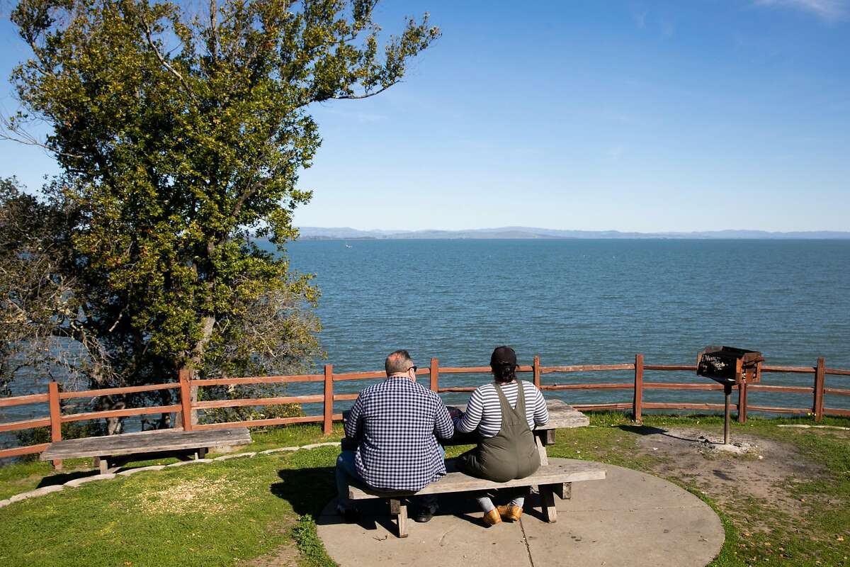Gina Puopolo and Aaron Drahmann take a work break for a picnic at China Camp State Park in San Rafael. The park was one of many in the Bay Area that recently reopened.