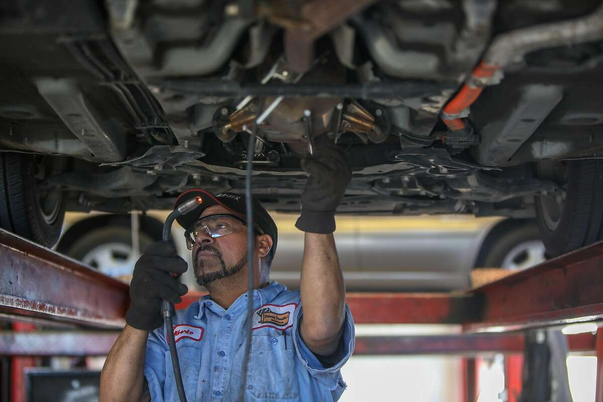 Alberto Pachuca, a mechanic, builds a protective cage for a catalytic converter in a Toyota Prius at Johnny Franklin Muffler on Wednesday, January 24, 2021, in Santa Rosa , Calif. Catalytic converter thefts are on the rise across the Bay Area and the nation, with thieves targeting the emissions device for its resale value on a black market that relies on a network of scrapyards and recyclers willing to deal in stolen parts. Those responsible for the robberies work at night and often travel from outside the areas they target, making it exceedingly difficult to catch them in the act. Many autobody shops see multiple catalytic converter replacements weekly, costing customers between $2,000 and $3,000.