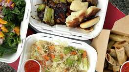 The menu at Christelle's Culinary Corner includes, clockwise from top, Haitian-Korean BBQ Chicken, fried lumpia, pancit noodles and kale-mango salad. Owner Christelle Chalmers operates from a leased trailer on South Union Street in New Braunfels.