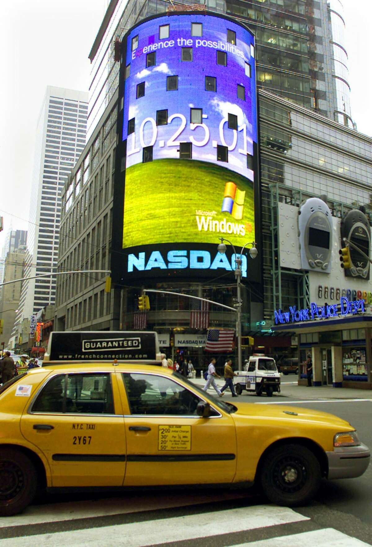 The NASDAQ sign in New York's Times Square announces the launch of the Microsoft Windows XP operating system scheduled for October 25, 2001.