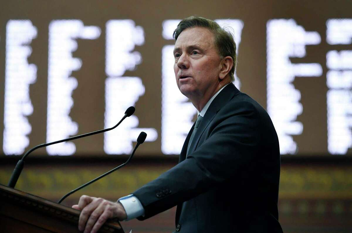 Gov. Ned Lamont, shown here in the state House of Representatives, wants to persuade state lawmakers to support a regional climate initiative that could raise gasoline prices by a nickel a gallon, but give the state $90 million a year to combat climate change.