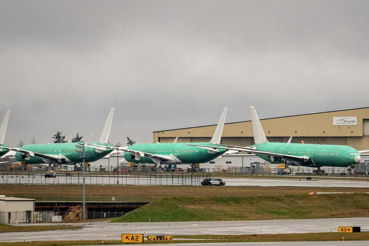 EVERETT, WA - FEBRUARY 22: Boeing 777X jetliners are seen parked at Boeings airplane production facility on February 22, 2021 in Everett, Washington. Following Saturday's engine failure on a Boeing 777 over Denver, the FAA issued an emergency inspection order for Boeing 777 aircraft with Pratt & Whitney engines. (Photo by David Ryder/Getty Images)