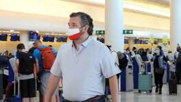 Texas Sen. Ted Cruz checks in for a return flight from Cancún, Mexico. When Texans were freezing, Cruz flew south for warmth. C'mon, Ted.