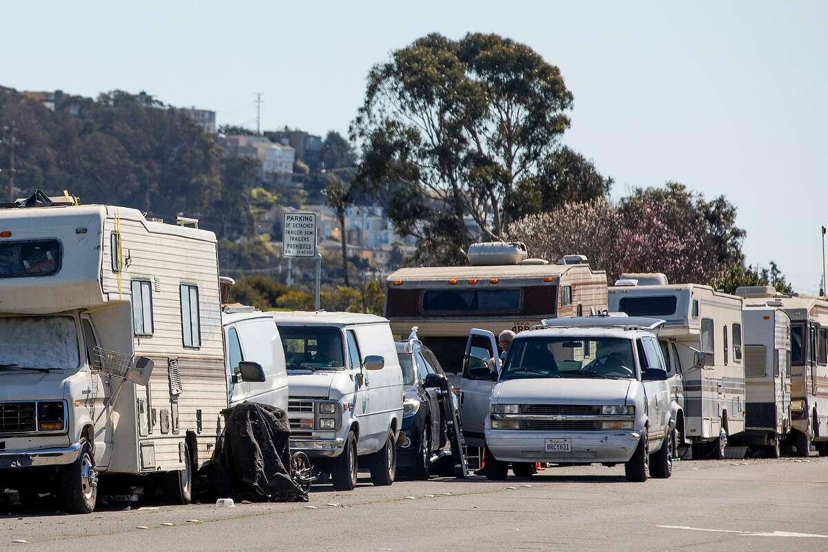 A row of RVs are seen parked at an encampment along Rydin Road in Richmond, Calif. Monday, February 22, 2021. Richmond city officials are interested in open an RV site for at least 30 people to reside. Richmond Mayor Tom Butt wants to open the site at Hilltop Mall, which could allow for 100 people to participate.