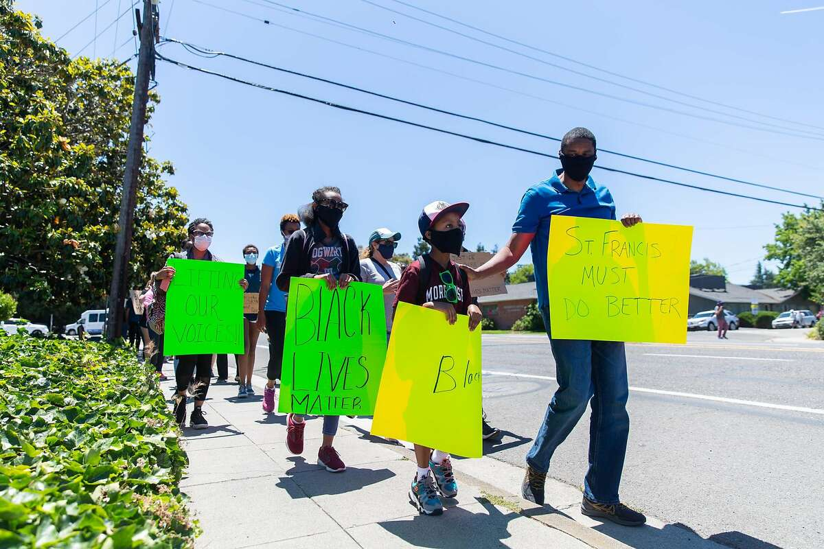 Saint Francis High School students and parents and local community members march down Miramonte Avenue in Mountain View on June 8, 2020. Photo by Magali Gauthier.