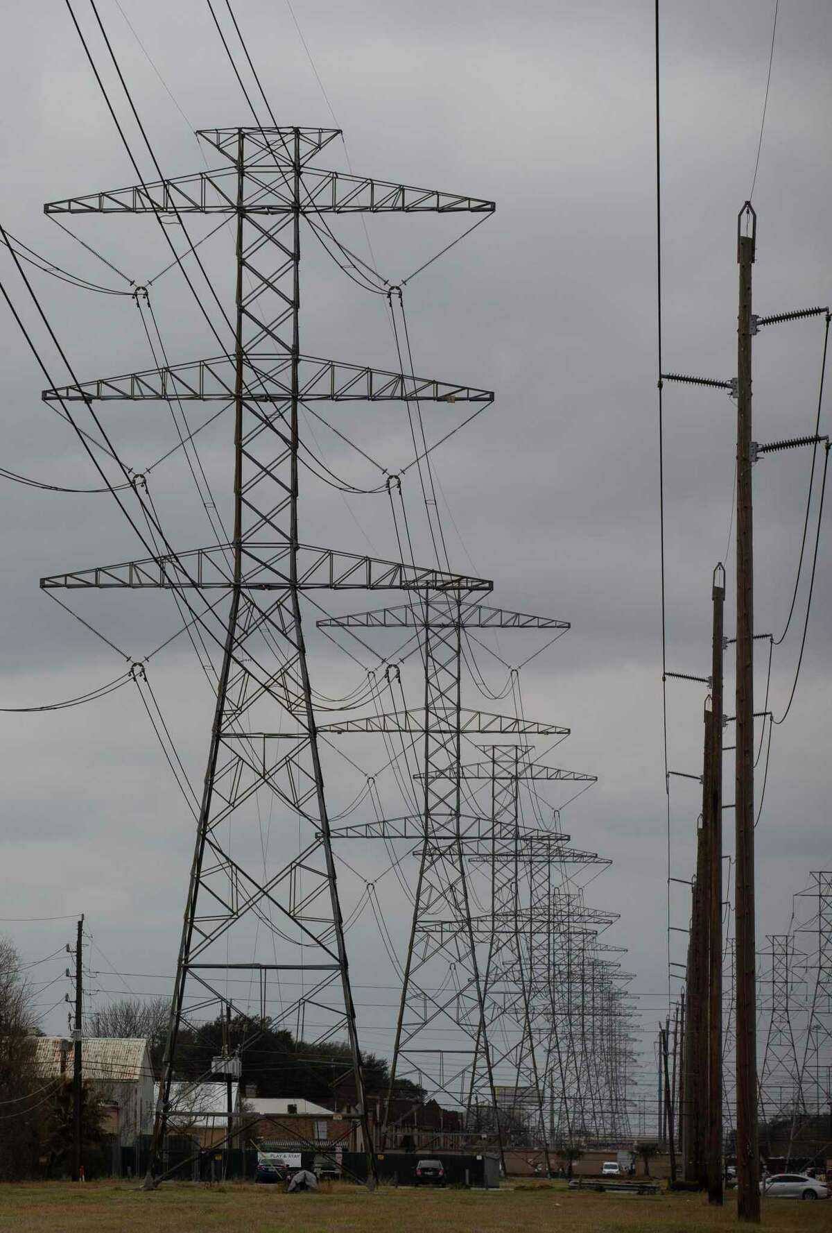 Power lines in Houston. Whether most electricity bills will go up following the recent power crisis will depend on several factors.