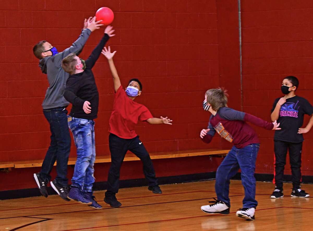 Students from local school grade schools including Rensselaer Park Elementary School play games in the gym at the Lansingburgh Boys & Girls Club on Tuesday, Feb. 23, 2021 in Troy, N.Y. This is the first week that the 3,4 and 5th graders from Rensselaer Park Elementary School return to school since the corona virus pandemic started. (Lori Van Buren/Times Union)