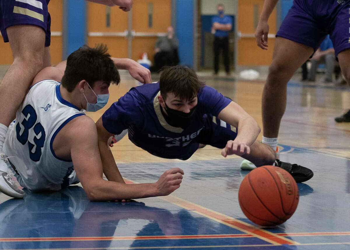 Saratoga's Chris Dufort and CBA's Colby Dodson reach for the ball during a game on Wednesday, Feb. 24, 2021, in Saratoga Springs, N.Y. (Jenn March, Special to the Times Union)