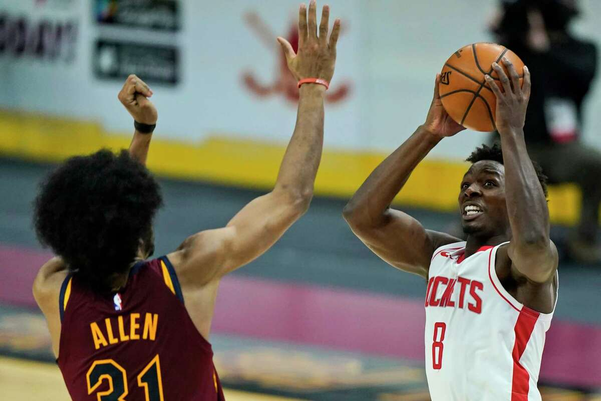 Houston Rockets' Jae'Sean Tate (8) shoots against Cleveland Cavaliers' Jarrett Allen (31) in the second half of an NBA basketball game, Wednesday, Feb. 24, 2021, in Cleveland. (AP Photo/Tony Dejak)