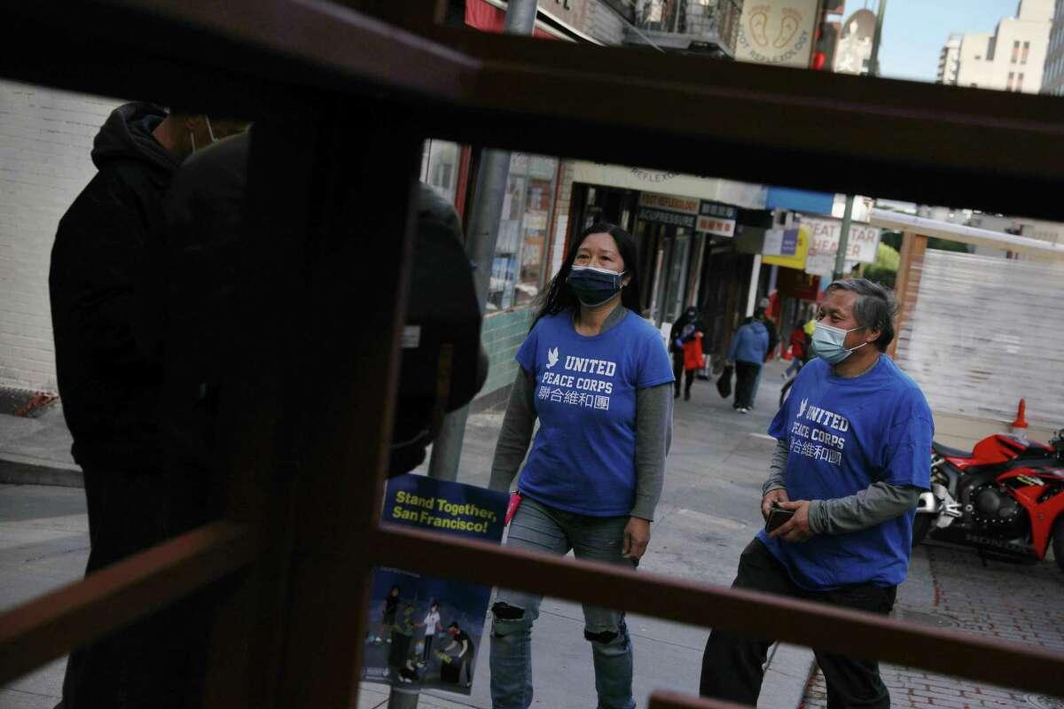 Members of a volunteer patrol walk through Chinatown in San Francisco.