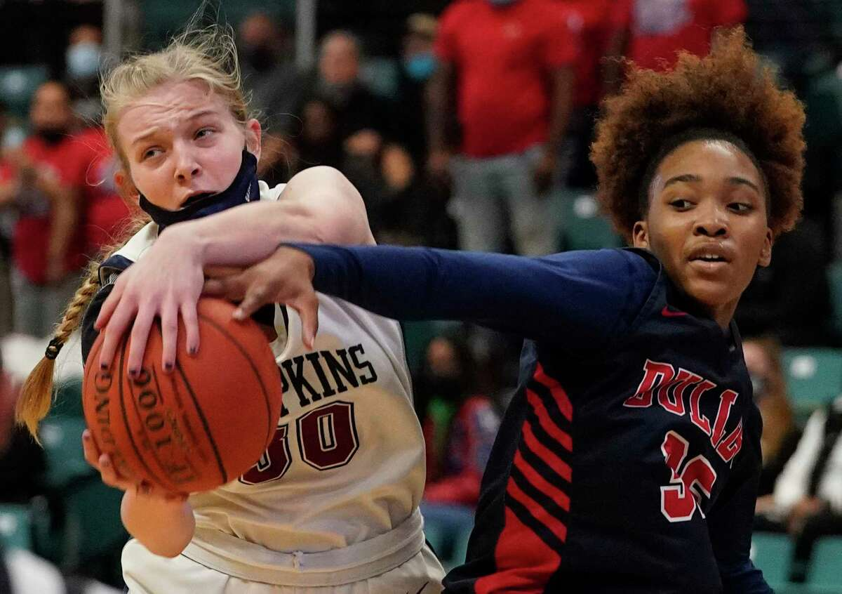 Tompkins Mackenzie Durnford (30) and Dulles Peyton Overton (35) scramble for a rebound during girls basketball playoff game at the Merrell Center Wednesday, Feb. 24, 2021 in Katy.