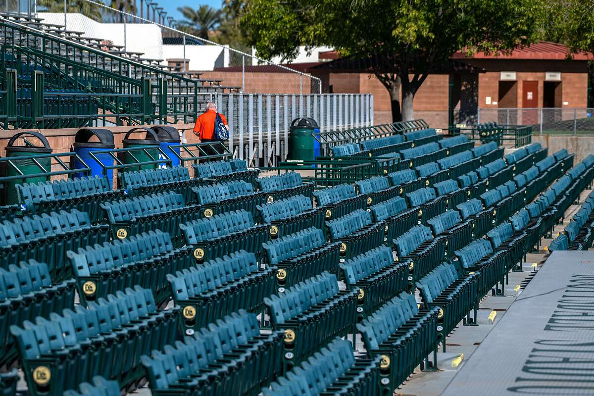 The typical masses of staff, spectators and press are missing from the first day of San Francisco Giants practice at Scottsdale stadium before opening day of Spring Training in the Cactus League, on Monday, Feb. 22, 2021, in Scottsdale, Ariz..