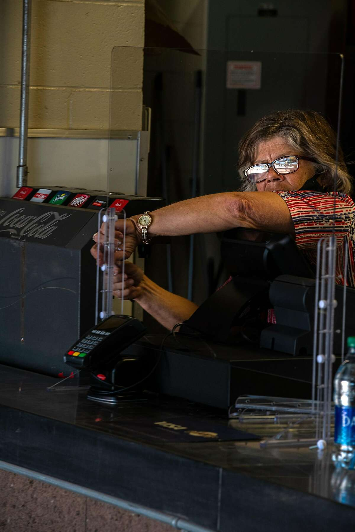 Vendors set up plexiglass barriers at the concessions during the first San Francisco Giants practice at Scottsdale stadium before opening day of Spring Training in the Cactus League, on Monday, Feb. 22, 2021, in Scottsdale, Ariz..
