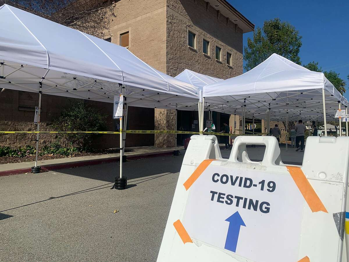 The entrance for coronavirus testing and coronavirus vaccinations is seen at Emmanuel Baptist Church on North White Road in East San Jose on Wednesday, Feb. 24, 2021. The church's gymnasium is now home to a large vaccination sitein partnership with Santa Clara Health System and church officials, and has served as a testing site since fall 2020.