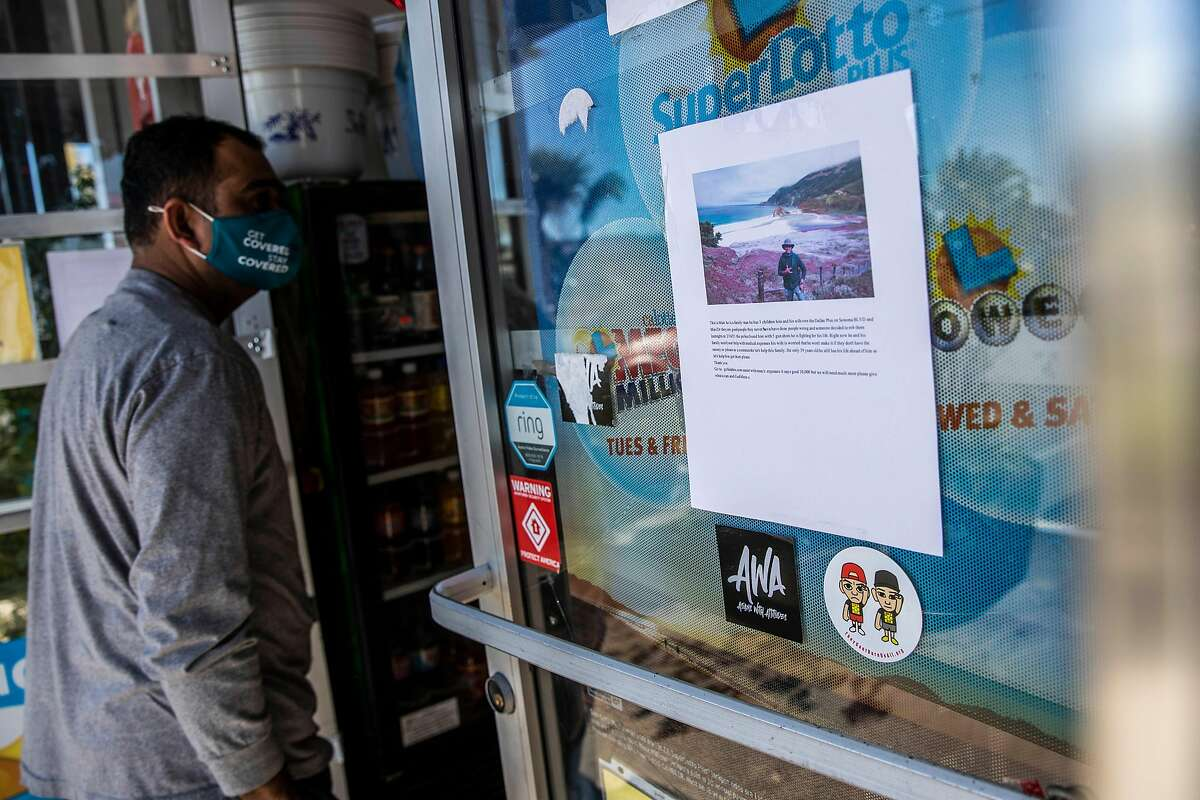 A poster on the door of Dollar Plus & Party Supplies in Vacaville refers to the shooting of store owner Marc Quidit.