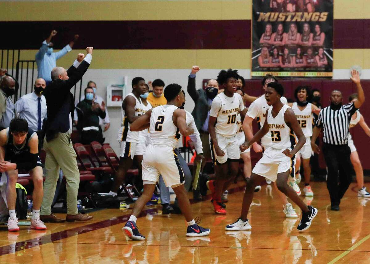 Cypress Ranch players react after their 47-46 win over College Park during a Region II-6A high school basketball area playoff game at Magnolia West High School, Wednesday, Feb. 24, 2021, in Magnolia.